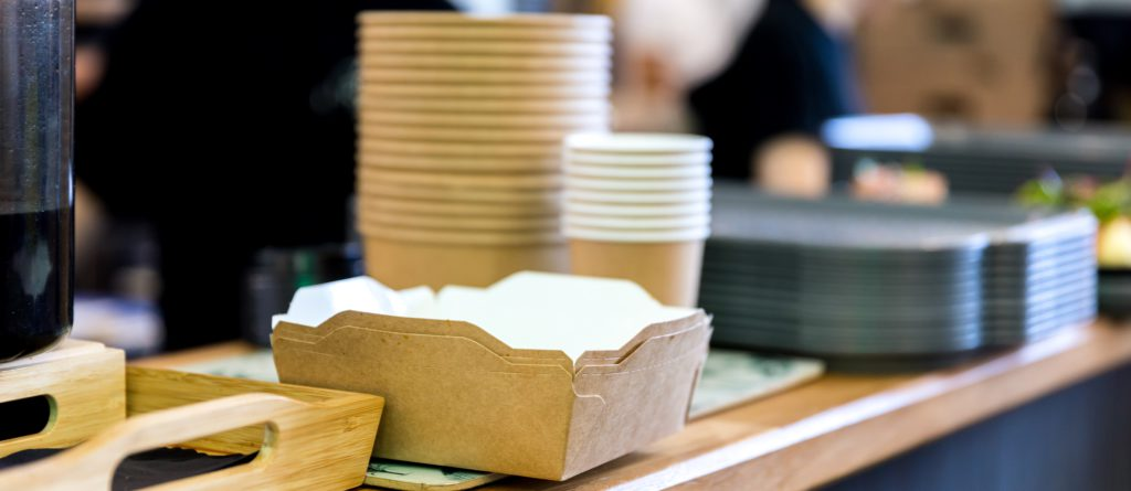 Paper box for takeaway dishes on a cafe counter